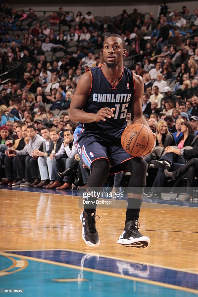 <a gi-track='captionPersonalityLinkClicked' href=/galleries/search?phrase=Kemba+Walker&family=editorial&specificpeople=5042442 ng-click='$event.stopPropagation()'>Kemba Walker</a> #15 of the Charlotte Bobcats gets ready to shoot against the Dallas Mavericks on October 26, 2012 at the American Airlines Center in Dallas, Texas.