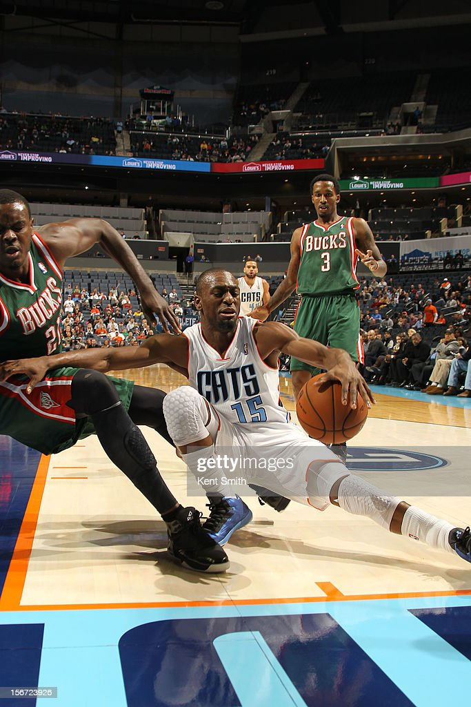 <a gi-track='captionPersonalityLinkClicked' href=/galleries/search?phrase=Kemba+Walker&family=editorial&specificpeople=5042442 ng-click='$event.stopPropagation()'>Kemba Walker</a> #15 of the Charlotte Bobcats goes down against <a gi-track='captionPersonalityLinkClicked' href=/galleries/search?phrase=Samuel+Dalembert&family=editorial&specificpeople=202026 ng-click='$event.stopPropagation()'>Samuel Dalembert</a> #21 of the Milwaukee Bucks at the Time Warner Cable Arena on November 19, 2012 in Charlotte, North Carolina.