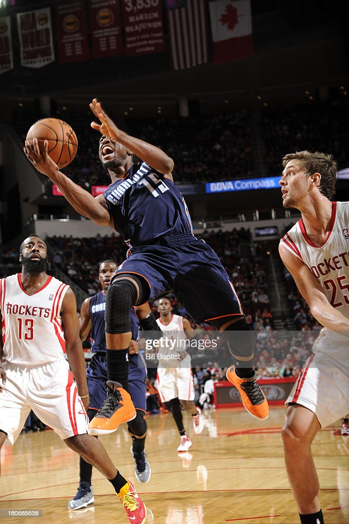 Kemba Walker #15 of the Charlotte Bobcats goes to the basket against Chandler Parsons #25 of the Houston Rockets on February 2, 2013 at the Toyota Center in Houston, Texas.