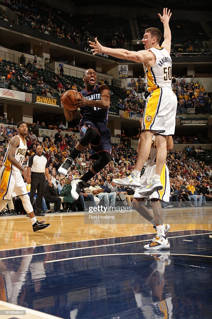 Kemba Walker #15 of the Charlotte Bobcats goes to the basket against Tyler Hansbrough #50 of the Indiana Pacers on February 13, 2013 at Bankers Life Fieldhouse in Indianapolis, Indiana.