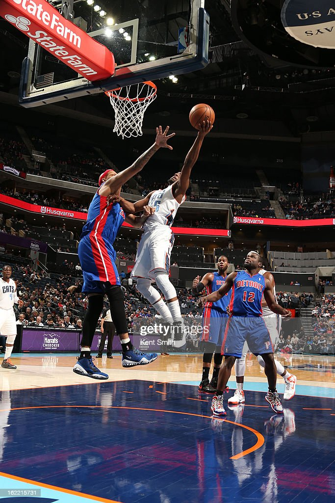 Kemba Walker #15 of the Charlotte Bobcats goes to the basket against Charlie Villanueva #31 of the Detroit Pistons at the Time Warner Cable Arena on February 20, 2013 in Charlotte, North Carolina.