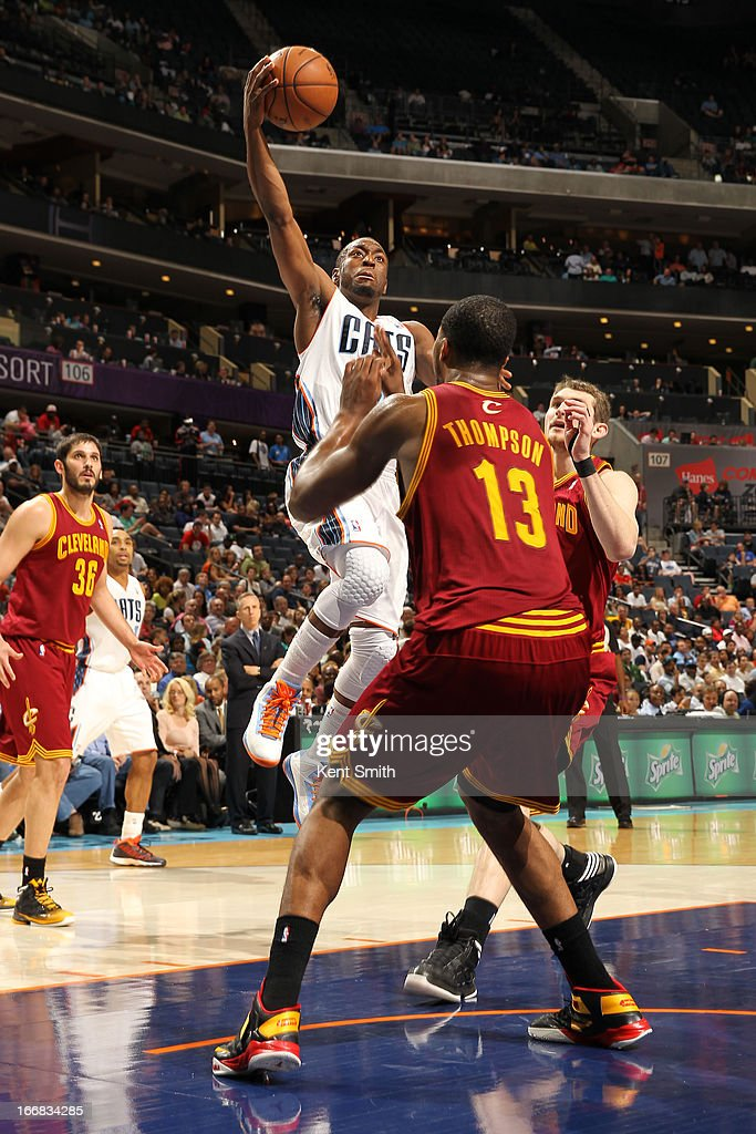 Kemba Walker #15 of the Charlotte Bobcats goes to the basket against Tristan Thompson #13 of the Cleveland Cavaliers at the Time Warner Cable Arena on April 17, 2013 in Charlotte, North Carolina.
