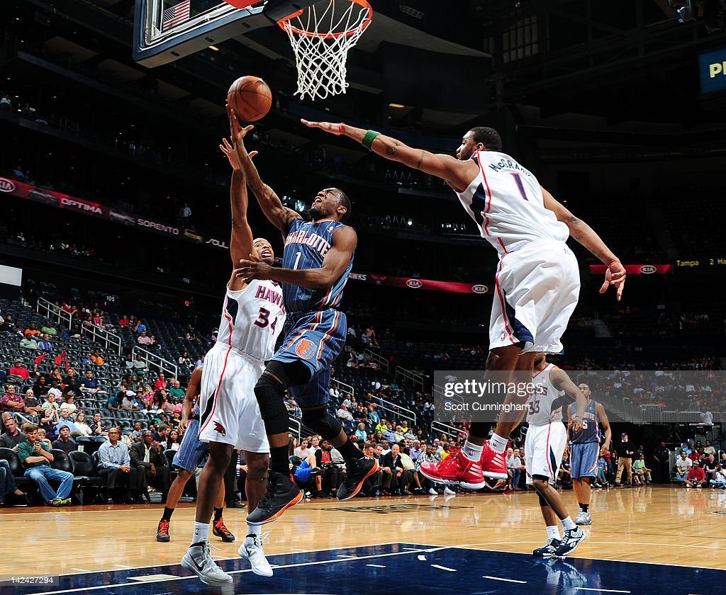 <a gi-track='captionPersonalityLinkClicked' href=/galleries/search?phrase=Kemba+Walker&family=editorial&specificpeople=5042442 ng-click='$event.stopPropagation()'>Kemba Walker</a> #1 of the Charlotte Bobcats goes to the basket against <a gi-track='captionPersonalityLinkClicked' href=/galleries/search?phrase=Jason+Collins+-+Basketball+Player&family=editorial&specificpeople=201926 ng-click='$event.stopPropagation()'>Jason Collins</a> #34 and <a gi-track='captionPersonalityLinkClicked' href=/galleries/search?phrase=Tracy+McGrady&family=editorial&specificpeople=201486 ng-click='$event.stopPropagation()'>Tracy McGrady</a> #1 of the Atlanta Hawks on April 4, 2012 at Philips Arena in Atlanta, Georgia.
