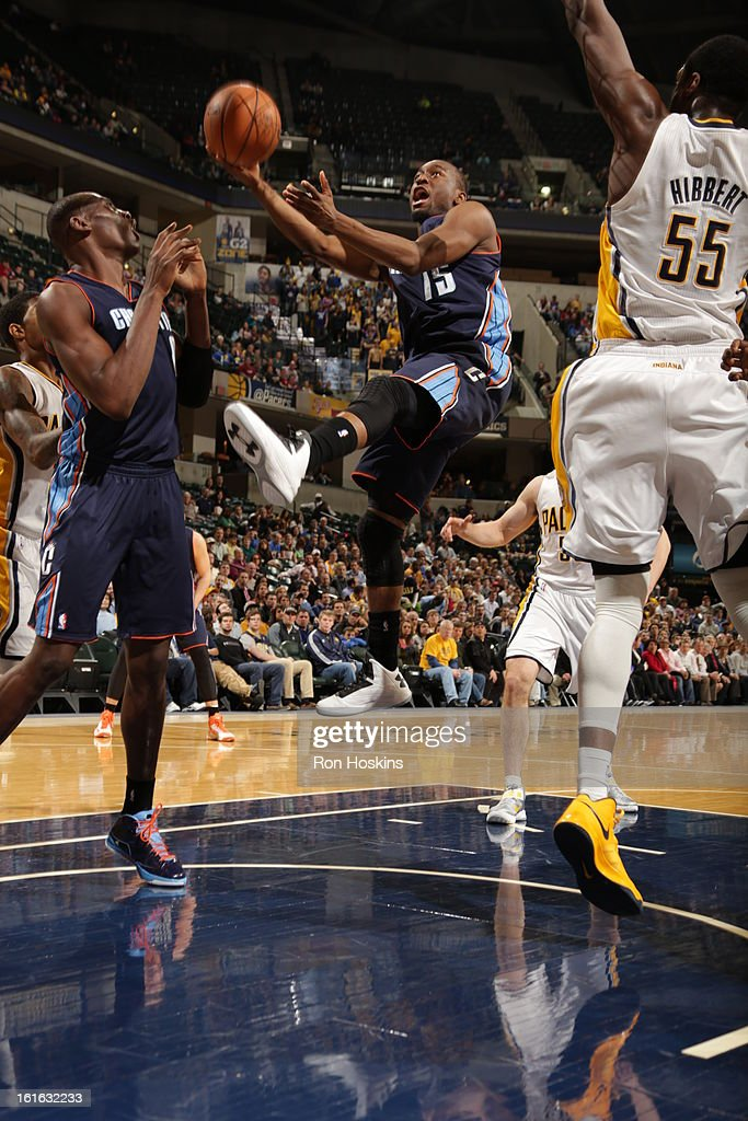 Kemba Walker #15 of the Charlotte Bobcats goes to the basket against Roy Hibbert #55 of the Indiana Pacers on February 13, 2013 at Bankers Life Fieldhouse in Indianapolis, Indiana.