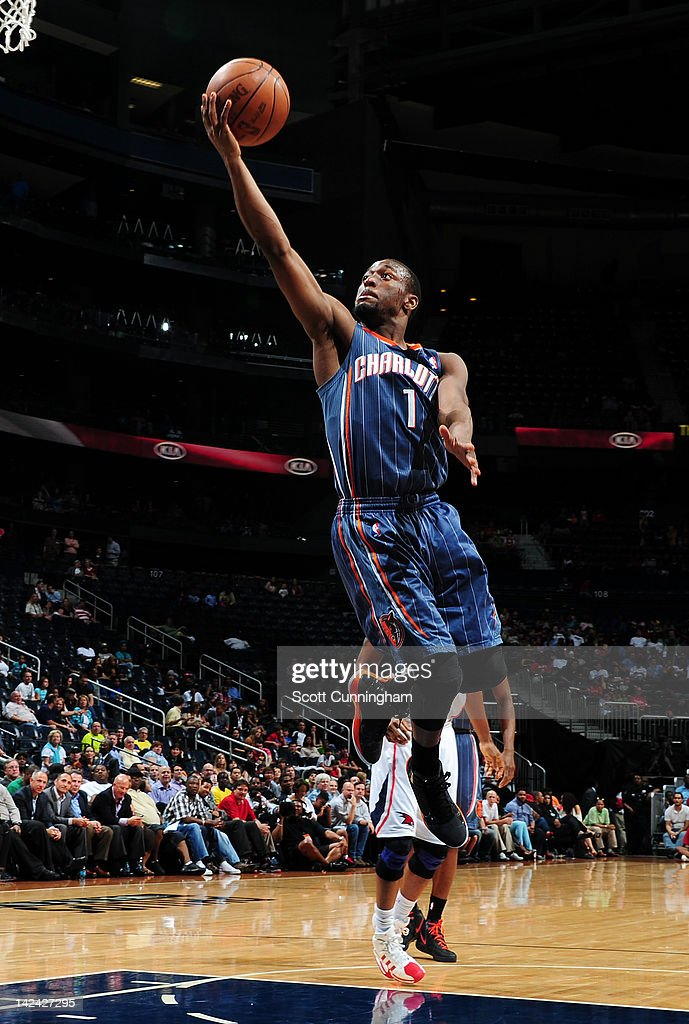 <a gi-track='captionPersonalityLinkClicked' href=/galleries/search?phrase=Kemba+Walker&family=editorial&specificpeople=5042442 ng-click='$event.stopPropagation()'>Kemba Walker</a> #1 of the Charlotte Bobcats goes to the basket against the Atlanta Hawks on April 4, 2012 at Philips Arena in Atlanta, Georgia.
