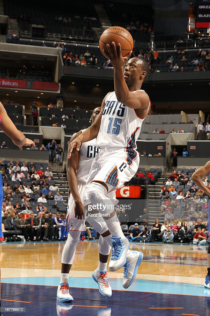 Kemba Walker #15 of the Charlotte Bobcats goes to the basket against the Philadelphia 76ers at the Time Warner Cable Arena on April 3, 2013 in Charlotte, North Carolina.