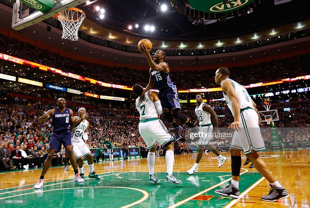Kemba Walker #15 of the Charlotte Bobcats goes up for a layup before being called for an offensive foul against Jared Sullinger #7 of the Boston Celtics during the game on January 14, 2013 at TD Garden in Boston, Massachusetts.