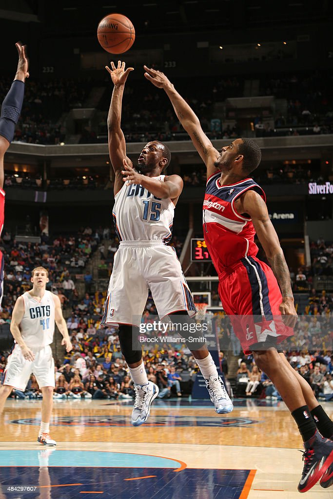 <a gi-track='captionPersonalityLinkClicked' href=/galleries/search?phrase=Kemba+Walker&family=editorial&specificpeople=5042442 ng-click='$event.stopPropagation()'>Kemba Walker</a> #15 of the Charlotte Bobcats goes up for a shot against the Washington Wizards at the Time Warner Cable Arena on March 31, 2014 in Charlotte, North Carolina.