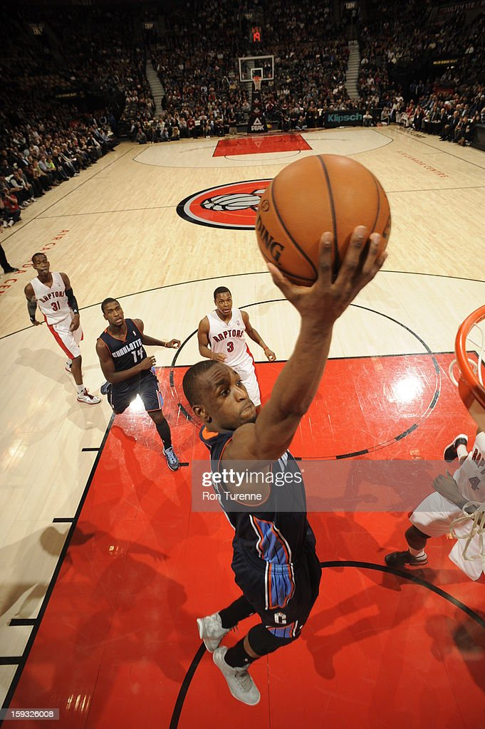 Kemba Walker #15 of the Charlotte Bobcats goes up for the easy layup against the Toronto Raptors during the game on January 11, 2013 at the Air Canada Centre in Toronto, Ontario, Canada.