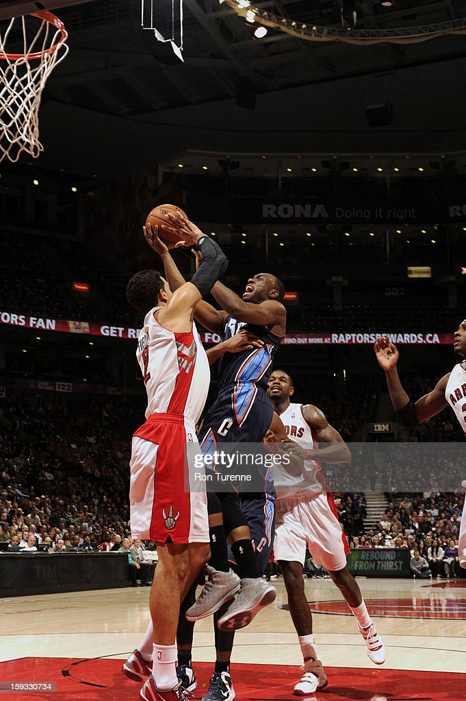 Kemba Walker #15 of the Charlotte Bobcats goes up in traffic against the Toronto Raptors during the game on January 11, 2013 at the Air Canada Centre in Toronto, Ontario, Canada.