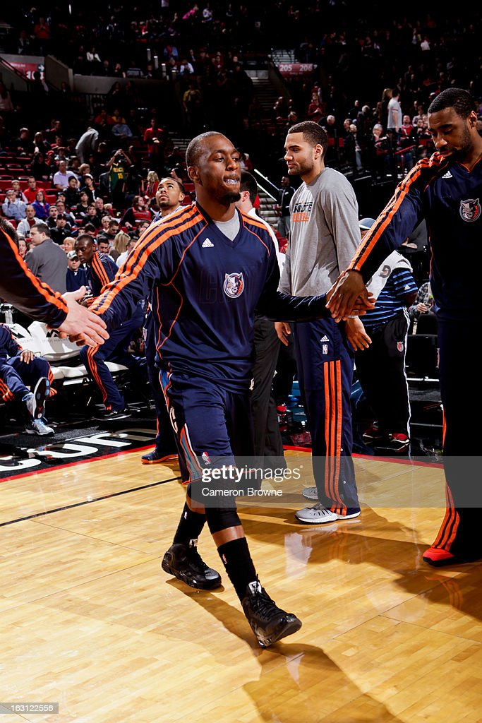 Kemba Walker #15 of the Charlotte Bobcats greets teammates before playing against the Portland Trail Blazers on March 4, 2013 at the Rose Garden Arena in Portland, Oregon.