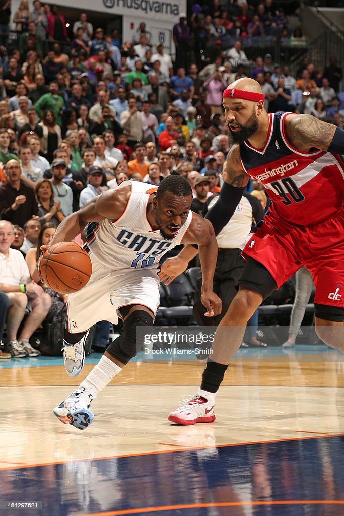 <a gi-track='captionPersonalityLinkClicked' href=/galleries/search?phrase=Kemba+Walker&family=editorial&specificpeople=5042442 ng-click='$event.stopPropagation()'>Kemba Walker</a> #15 of the Charlotte Bobcats handles the ball against the Washington Wizards at the Time Warner Cable Arena on March 31, 2014 in Charlotte, North Carolina.