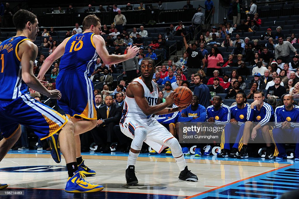 <a gi-track='captionPersonalityLinkClicked' href=/galleries/search?phrase=Kemba+Walker&family=editorial&specificpeople=5042442 ng-click='$event.stopPropagation()'>Kemba Walker</a> #15 of the Charlotte Bobcats looks to pass the ball against the Golden State Warriors at Time Warner Cable Arena on December 10, 2012 in Charlotte, North Carolina.