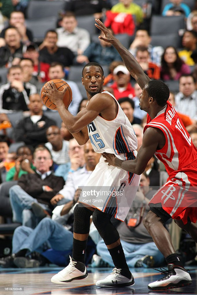 Kemba Walker #15 of the Charlotte Bobcats looks to pass the ball against Patrick Beverley #12 of the Houston Rockets at the Time Warner Cable Arena on January 21, 2013 in Charlotte, North Carolina.