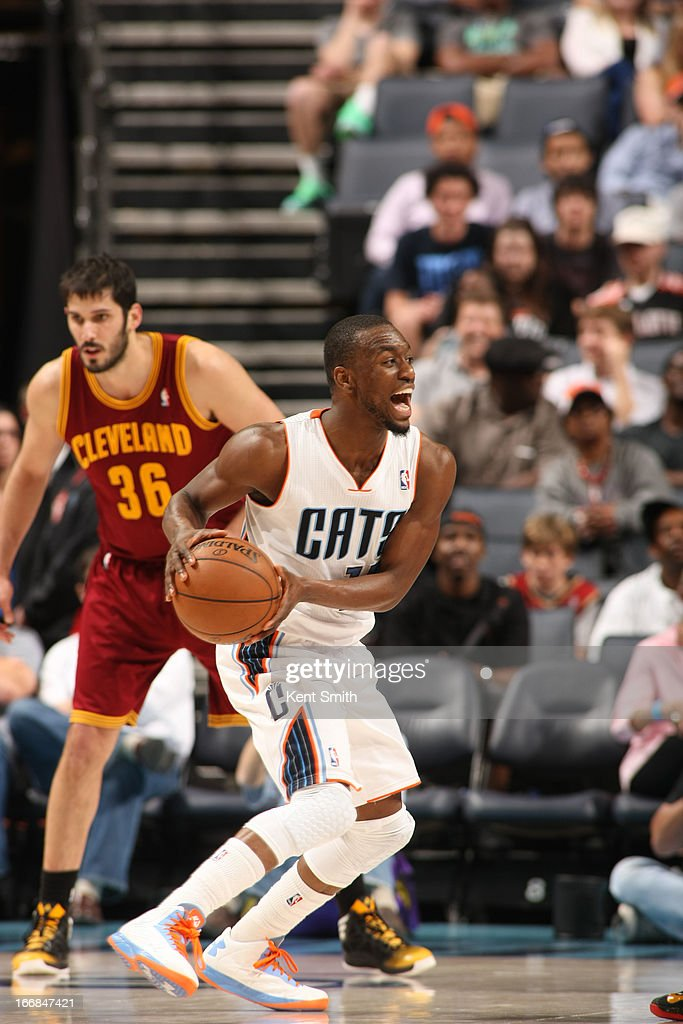 Kemba Walker #15 of the Charlotte Bobcats looks to pass the ball against the Cleveland Cavaliers at the Time Warner Cable Arena on April 17, 2013 in Charlotte, North Carolina.