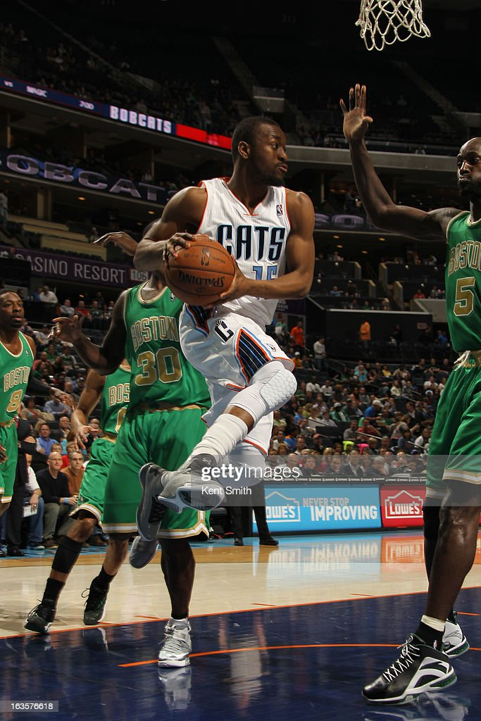 Kemba Walker #15 of the Charlotte Bobcats passes the ball against Kevin Garnett #5 of the Boston Celtics at the Time Warner Cable Arena on March 12, 2013 in Charlotte, North Carolina.