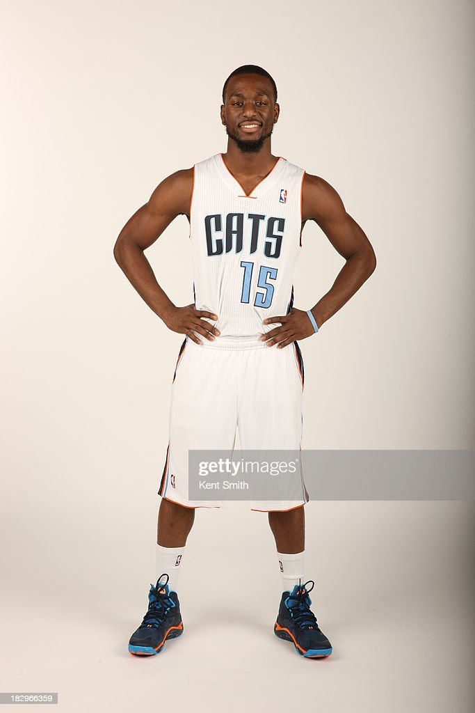 Kemba Walker #15 of the Charlotte Bobcats poses for a portrait on media day at the Time Warner Cable Arena on September 30, 2013 in Charlotte, North Carolina.