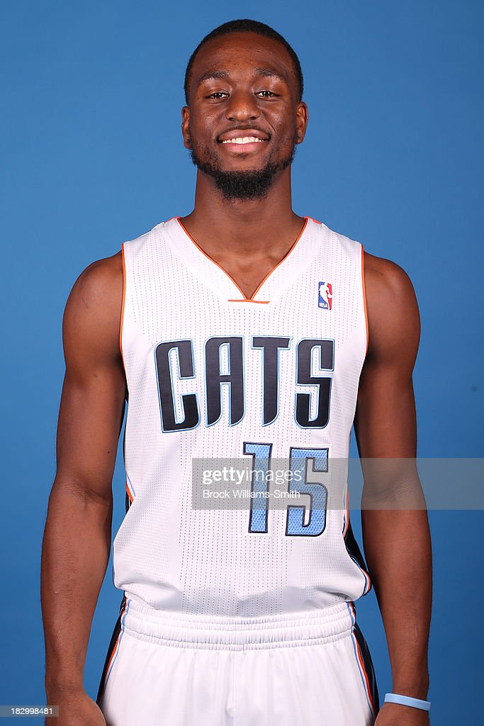 Kemba Walker #15 of the Charlotte Bobcats poses for media day at the Time Warner Cable Arena on September 20, 2013 in Charlotte, North Carolina.