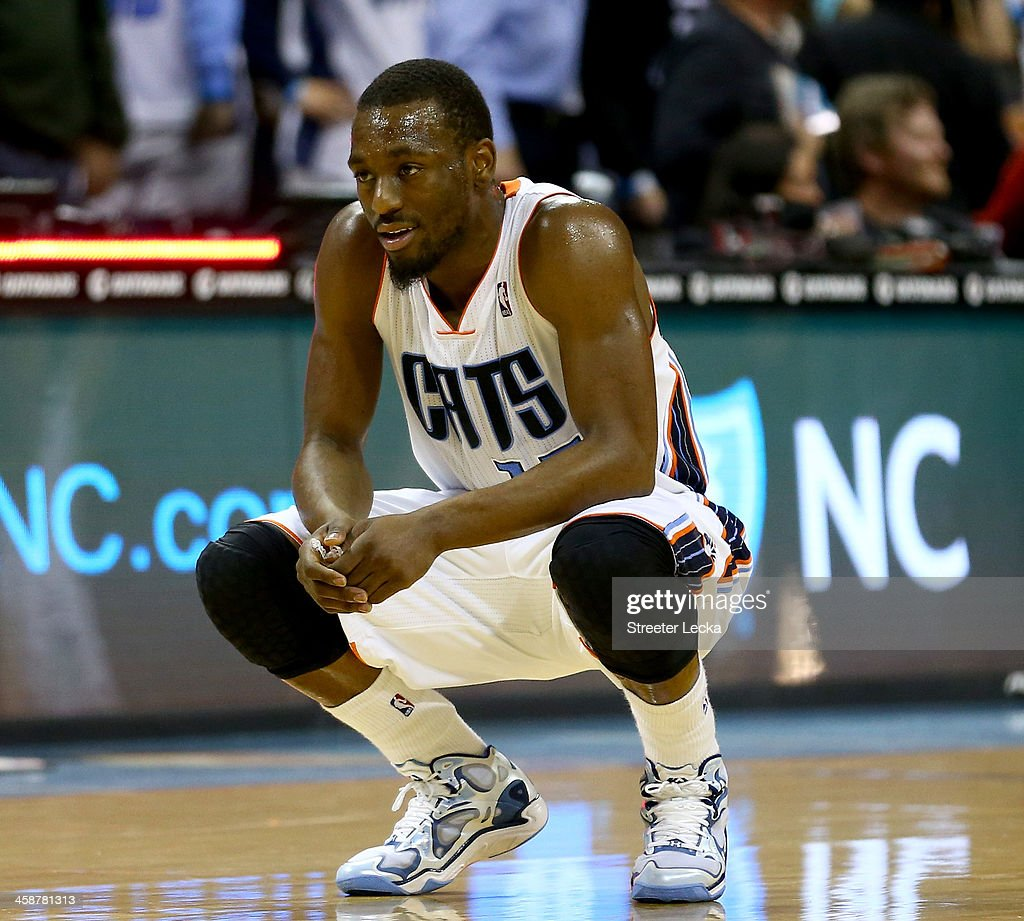 Kemba Walker #15 of the Charlotte Bobcats reacts after loosing to the Utah Jazz 88-85 in their game at Time Warner Cable Arena on December 21, 2013 in Charlotte, North Carolina.