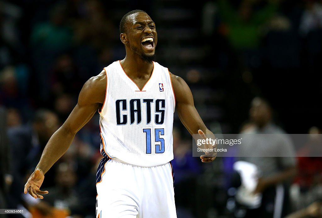 <a gi-track='captionPersonalityLinkClicked' href=/galleries/search?phrase=Kemba+Walker&family=editorial&specificpeople=5042442 ng-click='$event.stopPropagation()'>Kemba Walker</a> #15 of the Charlotte Bobcats reacts after making a basket during their game against the Brooklyn Nets at Time Warner Cable Arena on November 20, 2013 in Charlotte, North Carolina.