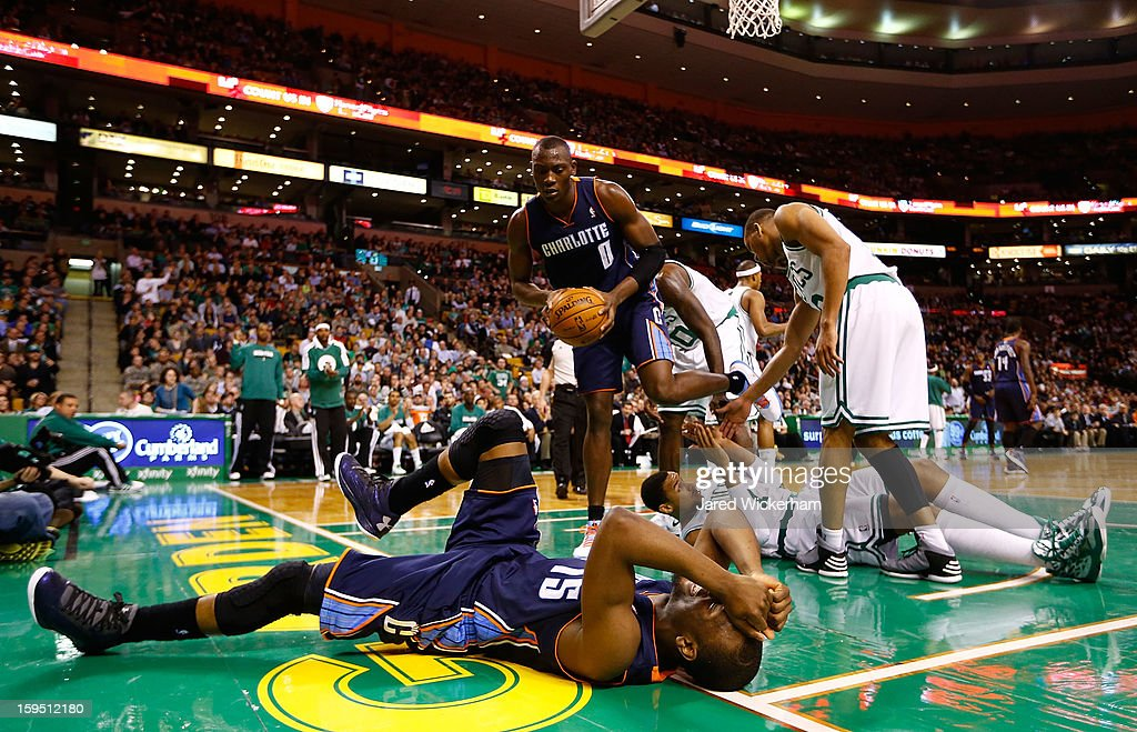 Kemba Walker #15 of the Charlotte Bobcats reacts after missing a layup and being called for an offensive foul against Jared Sullinger #7 of the Boston Celtics during the game on January 14, 2013 at TD Garden in Boston, Massachusetts.