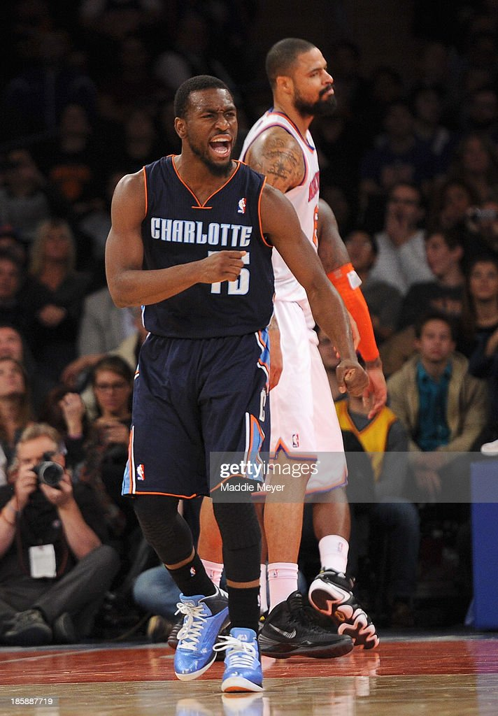<a gi-track='captionPersonalityLinkClicked' href=/galleries/search?phrase=Kemba+Walker&family=editorial&specificpeople=5042442 ng-click='$event.stopPropagation()'>Kemba Walker</a> #15 of the Charlotte Bobcats reacts after scoring against the New York Knicks in the fourth quarter at Madison Square Garden on October 25, 2013 in New York City. The Bobcats defeat the Knicks 85-83.