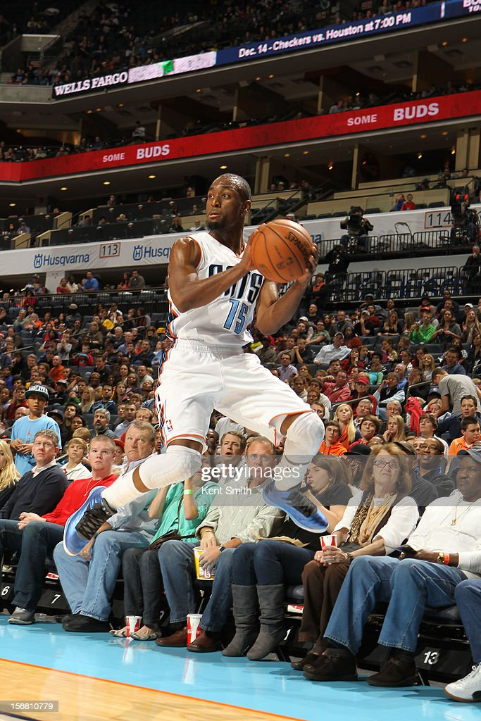 <a gi-track='captionPersonalityLinkClicked' href=/galleries/search?phrase=Kemba+Walker&family=editorial&specificpeople=5042442 ng-click='$event.stopPropagation()'>Kemba Walker</a> #15 of the Charlotte Bobcats saves the ball from out-of-bounds against the Toronto Raptors at the Time Warner Cable Arena on November 21, 2012 in Charlotte, North Carolina.