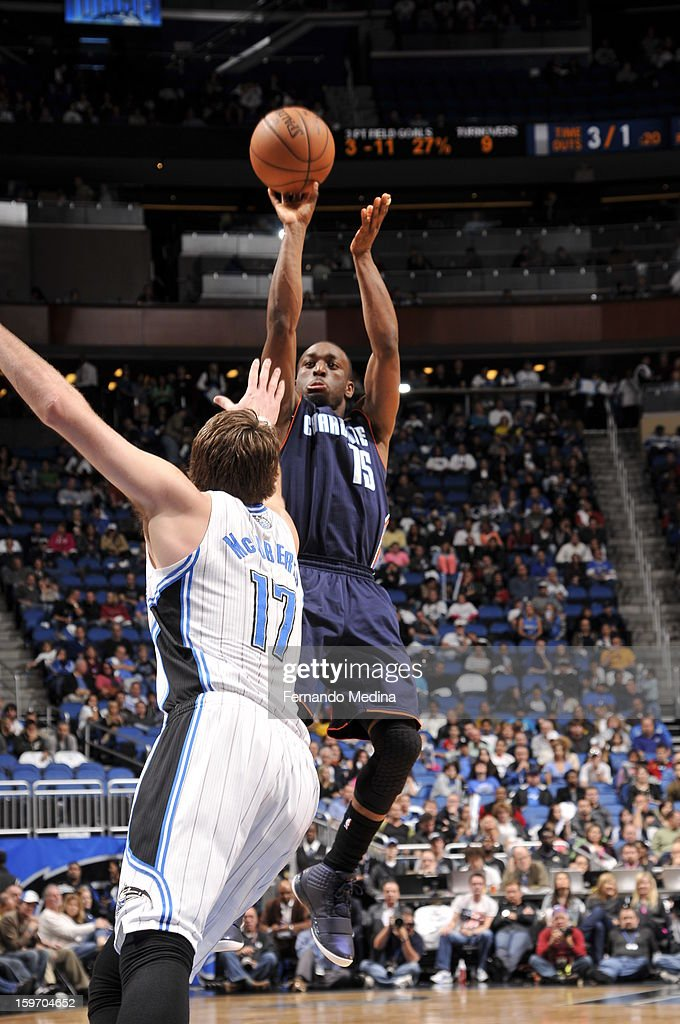 Kemba Walker #15 of the Charlotte Bobcats shoots a jumper against Josh McRoberts #17 of the Orlando Magic on January 18, 2013 at Amway Center in Orlando, Florida.
