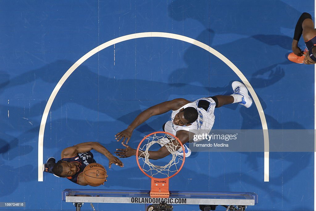 Kemba Walker #15 of the Charlotte Bobcats shoots a layup against Andrew Nicholson #44 of the Orlando Magic on January 18, 2013 at Amway Center in Orlando, Florida.