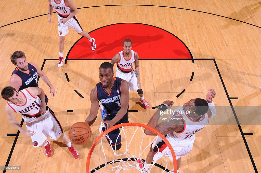 Kemba Walker #15 of the Charlotte Bobcats shoots a layup against the Portland Trail Blazers on March 4, 2013 at the Rose Garden Arena in Portland, Oregon.