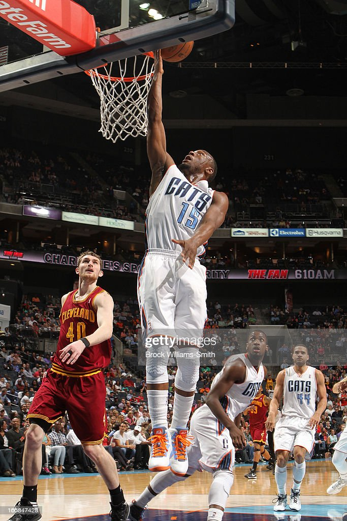 Kemba Walker #15 of the Charlotte Bobcats shoots a layup against Tyler Zeller #40 of the Cleveland Cavaliers at the Time Warner Cable Arena on April 17, 2013 in Charlotte, North Carolina.