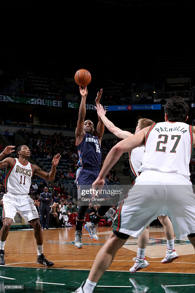 Kemba Walker #15 of the Charlotte Bobcats shoots against (L-R) Brandon Knight #11 and Nate Wolters #6 of the Milwaukee Bucks on March 16, 2014 at the BMO Harris Bradley Center in Milwaukee, Wisconsin.