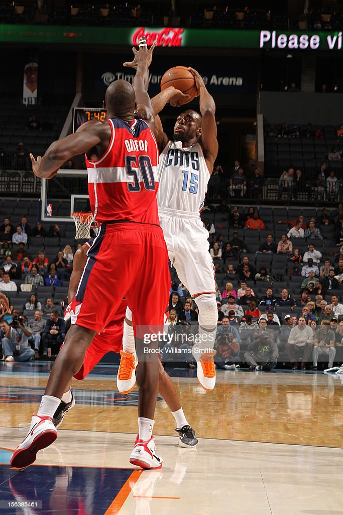 <a gi-track='captionPersonalityLinkClicked' href=/galleries/search?phrase=Kemba+Walker&family=editorial&specificpeople=5042442 ng-click='$event.stopPropagation()'>Kemba Walker</a> #15 of the Charlotte Bobcats shoots against <a gi-track='captionPersonalityLinkClicked' href=/galleries/search?phrase=Emeka+Okafor&family=editorial&specificpeople=201739 ng-click='$event.stopPropagation()'>Emeka Okafor</a> #50 of the Washington Wizards at the Time Warner Cable Arena on November 13, 2012 in Charlotte, North Carolina.
