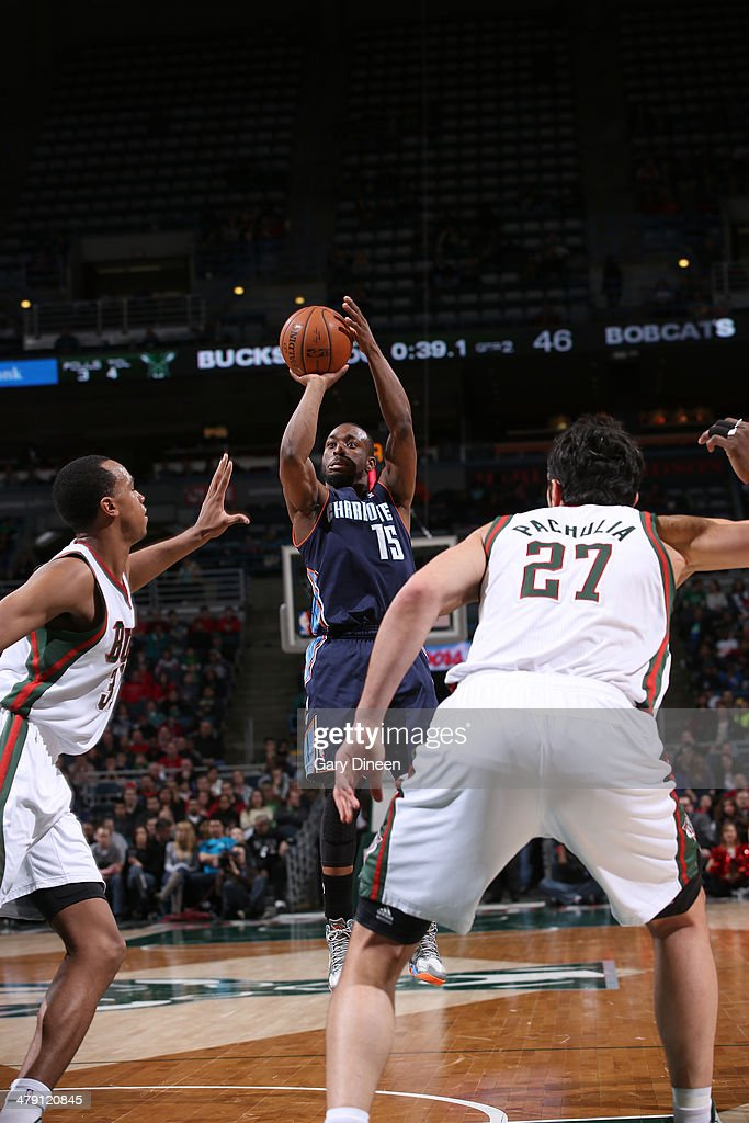 Kemba Walker #15 of the Charlotte Bobcats shoots against John Henson #31 of the Milwaukee Bucks on March 16, 2014 at the BMO Harris Bradley Center in Milwaukee, Wisconsin.