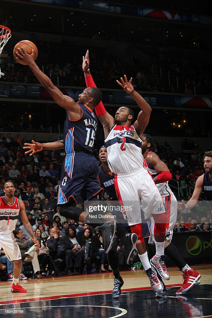 Kemba Walker #15 of the Charlotte Bobcats shoots against John Wall #2 of the Washington Wizards during the game at the Verizon Center on March 9, 2013 in Washington, DC.