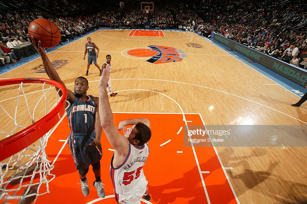 Kemba Walker #1 of the Charlotte Bobcats shoots against Josh Harrellson #55 of the New York Knicks on January 9, 2012 at Madison Square Garden in New York City.