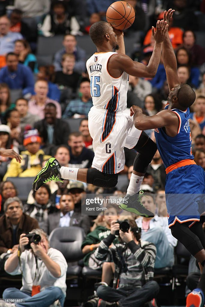 Kemba Walker #15 of the Charlotte Bobcats shoots against Raymond Felton #2 of the New York Knicks during the game at the Time Warner Cable Arena on November 8, 2013 in Charlotte, North Carolina.