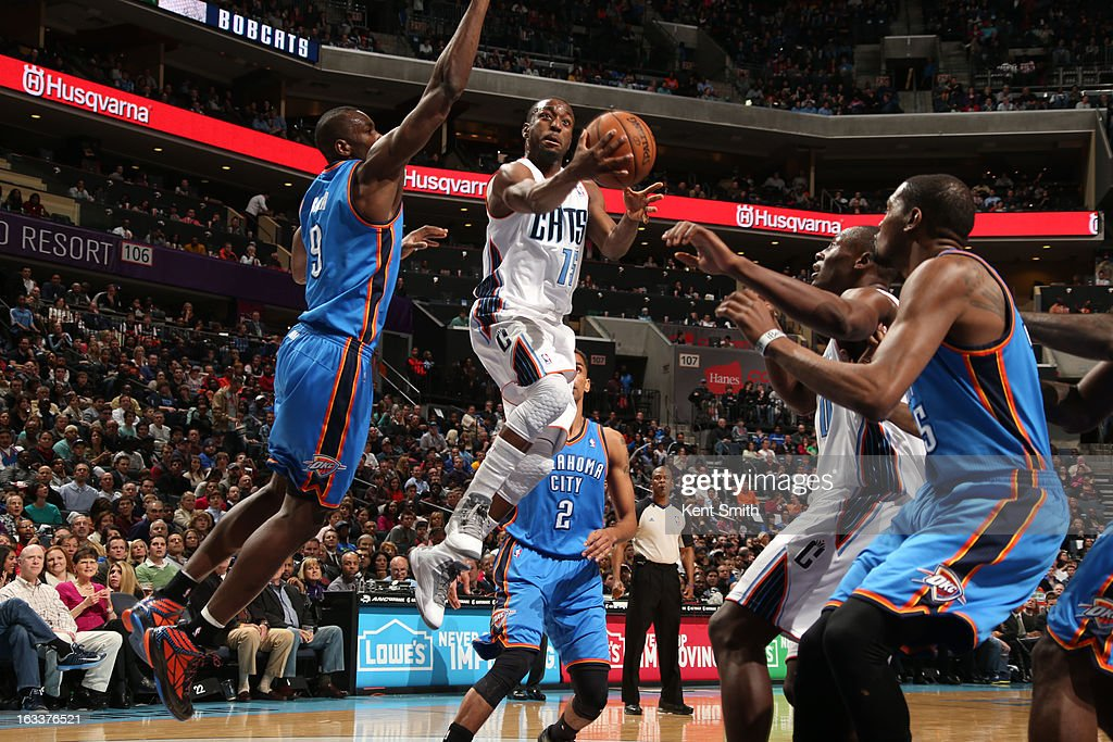 Kemba Walker #15 of the Charlotte Bobcats shoots against Serge Ibaka #9 and the Oklahoma City Thunder at the Time Warner Cable Arena on March 8, 2013 in Charlotte, North Carolina.