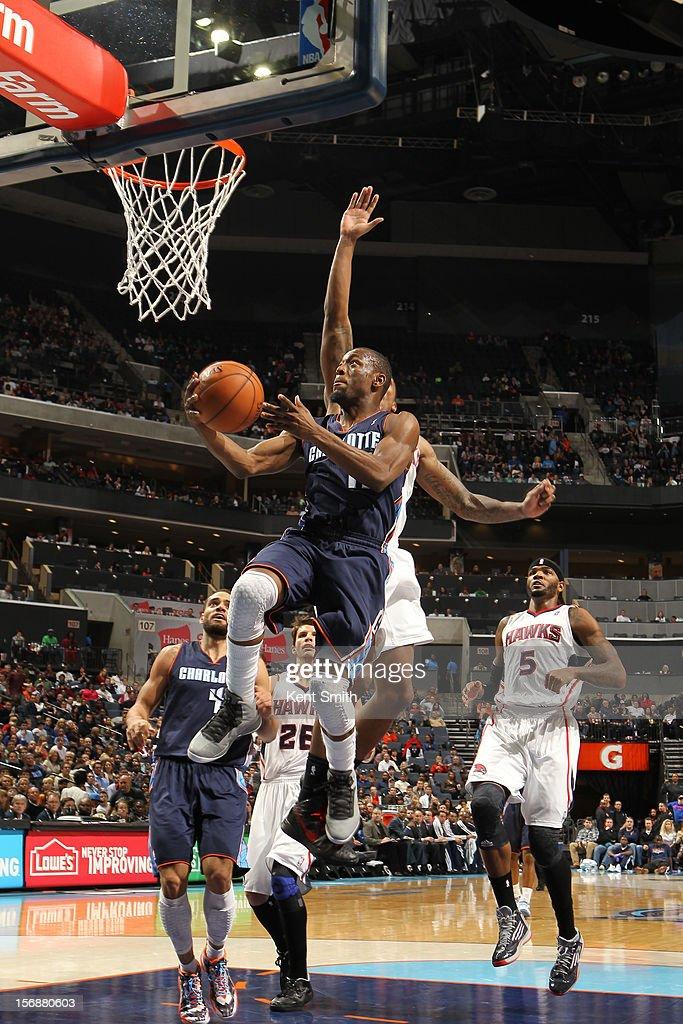 Kemba Walker #15 of the Charlotte Bobcats shoots against the Atlanta Hawks at the Time Warner Cable Arena on November 23, 2012 in Charlotte, North Carolina.
