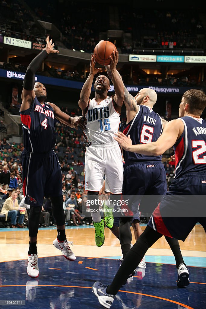 Kemba Walker #15 of the Charlotte Bobcats shoots against the Atlanta Hawks during the game at the Time Warner Cable Arena on March 17, 2014 in Charlotte, North Carolina.