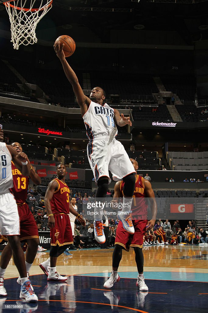 <a gi-track='captionPersonalityLinkClicked' href=/galleries/search?phrase=Kemba+Walker&family=editorial&specificpeople=5042442 ng-click='$event.stopPropagation()'>Kemba Walker</a> #15 of the Charlotte Bobcats shoots against the Cleveland Cavaliers during the game at the Time Warner Cable Arena on October 24, 2013 in Charlotte, North Carolina.