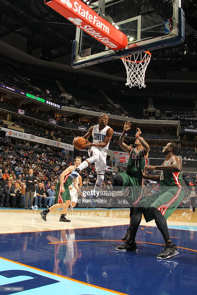 <a gi-track='captionPersonalityLinkClicked' href=/galleries/search?phrase=Kemba+Walker&family=editorial&specificpeople=5042442 ng-click='$event.stopPropagation()'>Kemba Walker</a> #15 of the Charlotte Bobcats shoots against the Milwaukee Bucks at the Time Warner Cable Arena on November 19, 2012 in Charlotte, North Carolina.