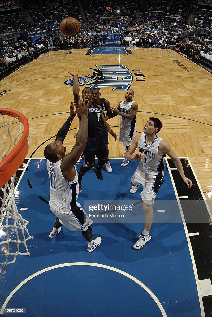 Kemba Walker #15 of the Charlotte Bobcats shoots over Glen Davis #11 of the Orlando Magic on January 18, 2013 at Amway Center in Orlando, Florida.
