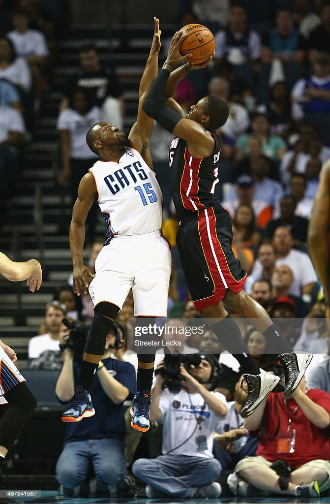 Kemba Walker #15 of the Charlotte Bobcats stops Mario Chalmers #15 of the Miami Heat in Game Four of the Eastern Conference Quarterfinals during the 2014 NBA Playoffs at Time Warner Cable Arena on April 28, 2014 in Charlotte, North Carolina.