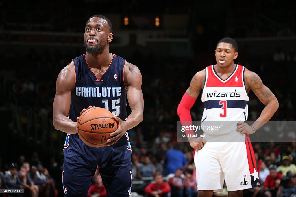 Kemba Walker #15 of the Charlotte Bobcats takes a free throw against the Washington Wizards at the Verizon Center on April 9, 2014 in Washington, DC.