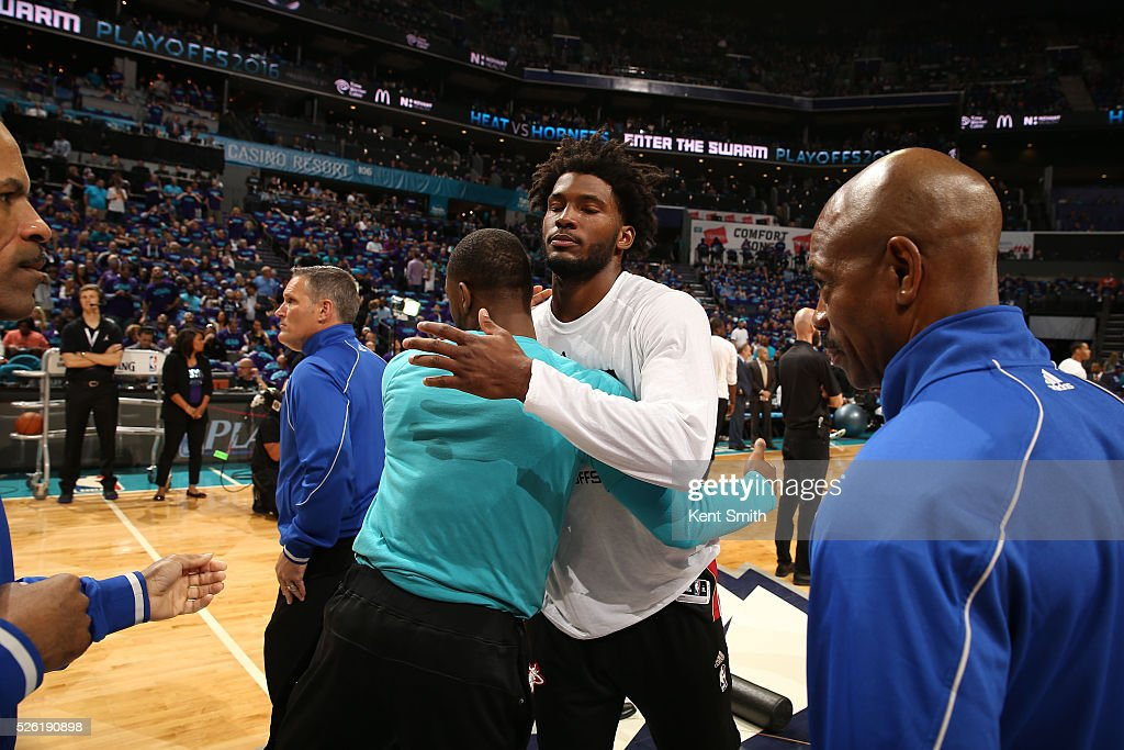 <a gi-track='captionPersonalityLinkClicked' href=/galleries/search?phrase=Kemba+Walker&family=editorial&specificpeople=5042442 ng-click='$event.stopPropagation()'>Kemba Walker</a> #15 of the Charlotte Hornets and <a gi-track='captionPersonalityLinkClicked' href=/galleries/search?phrase=Justise+Winslow&family=editorial&specificpeople=11268130 ng-click='$event.stopPropagation()'>Justise Winslow</a> #20 of the Miami Heat greet each other before Game Six of the Eastern Conference Quarterfinals during the 2016 NBA Playoffs on April 29, 2016 at Time Warner Cable Arena in Charlotte, North Carolina.