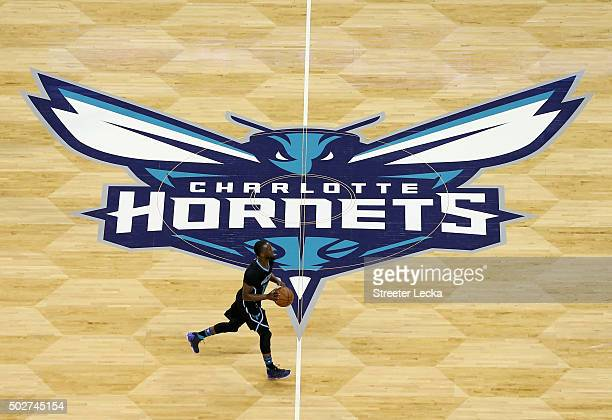 Kemba Walker of the Charlotte Hornets brings the ball up the court during their game against the Los Angeles Lakers at Time Warner Cable Arena on...