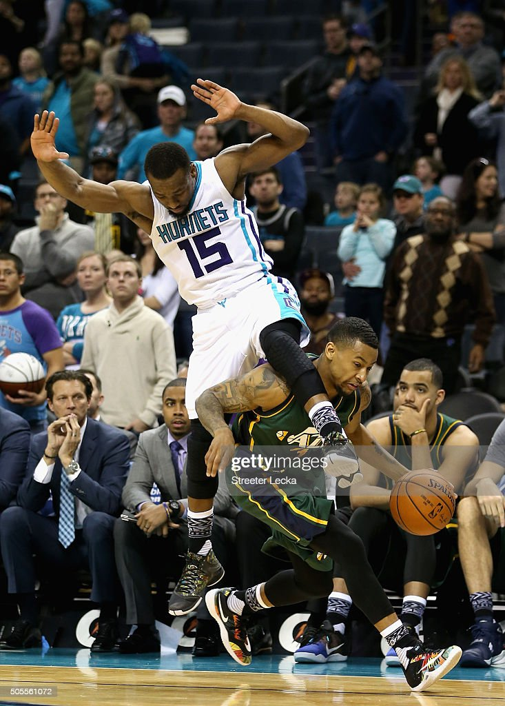 Kemba Walker #15 of the Charlotte Hornets collides with Trey Burke #3 of the Utah Jazz during their game at Time Warner Cable Arena on January 18, 2016 in Charlotte, North Carolina.