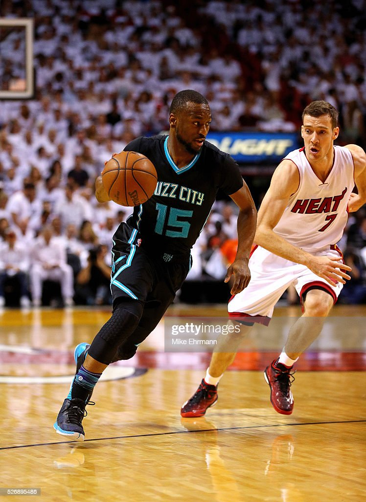 Kemba Walker #15 of the Charlotte Hornets drives past Goran Dragic #7 of the Miami Heat during Game Seven of the Eastern Conference Quarterfinals of the 2016 NBA Playoffs at American Airlines Arena on May 1, 2016 in Miami, Florida.