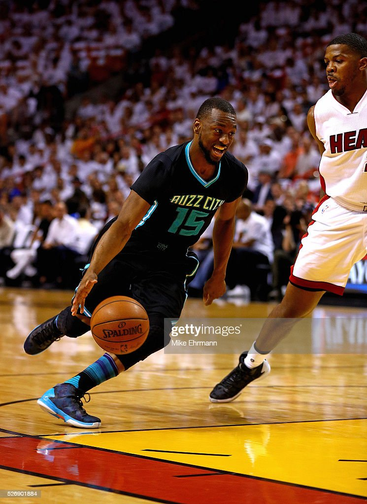 <a gi-track='captionPersonalityLinkClicked' href=/galleries/search?phrase=Kemba+Walker&family=editorial&specificpeople=5042442 ng-click='$event.stopPropagation()'>Kemba Walker</a> #15 of the Charlotte Hornets drives past <a gi-track='captionPersonalityLinkClicked' href=/galleries/search?phrase=Joe+Johnson+-+Basketball+Player&family=editorial&specificpeople=201652 ng-click='$event.stopPropagation()'>Joe Johnson</a> #2 of the Miami Heat during Game Seven of the Eastern Conference Quarterfinals of the 2016 NBA Playoffs at American Airlines Arena on May 1, 2016 in Miami, Florida.
